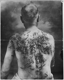 Man Tarred and Feathered for not Buying War Bonds